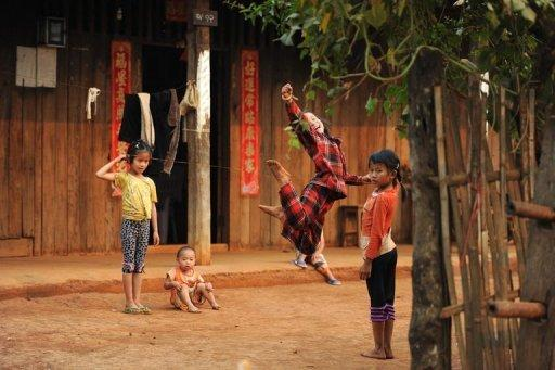 Ethnic Koe Kant children play in front of their house at a village near Lashio