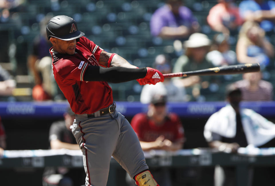 Arizona Diamondbacks' Ketel Marte connects for an RBI-single off Colorado Rockies starting pitcher Kyle Freeland in the first inning of a baseball game Wednesday, Aug. 14, 2019, in Denver. (AP Photo/David Zalubowski)