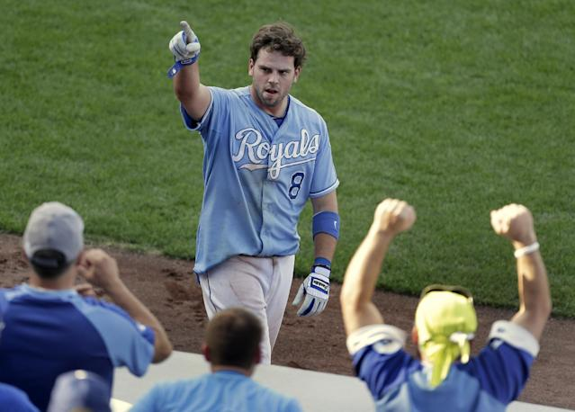 FILE - In this Sept. 5, 2013 file photo, Kansas City Royals' Mike Moustakas (8) celebrates after hitting a solo home run to win a baseball game during the 13th inning against the Seattle Mariners, in Kansas City, Mo. Moustakas walked through the empty ballroom with such a confident swagger that it was hard to believe the Royals third baseman was coming off one of the toughest seasons of his career _ and heading into one of the most important ones. (AP Photo/Charlie Riedel, File)