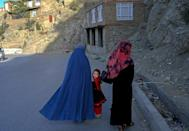 Despite the reurn of the Taliban, women can still be seen on the streets of Kabul (AFP/BULENT KILIC)