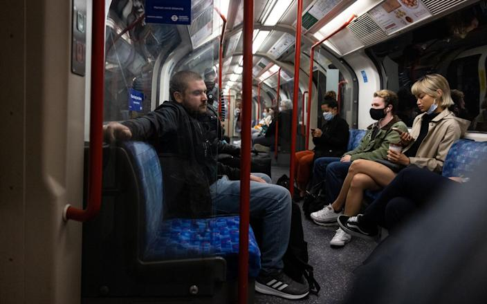 Commuters travel on the underground network during rush hour on July 06, 2021 in London, England. The UK government will no longer compel mask-wearing in enclosed spaces after Covid-19 rules end in England on July 19, but it has left the door open for individual transport providers to require them. - Getty Images