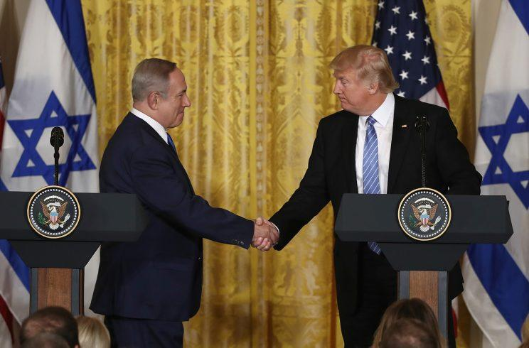 President Trump and Israeli Prime Minister Benjamin Netanyahu shake hands during a joint news conference at the East Room of the White House on Wednesday. (Photo: Win McNamee/Getty Images)