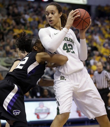 Baylor center Brittney Griner (42) works the ball against Kansas State's Marian White (22) during the first half of an NCAA college basketball game in the Big 12 Conference tournament Saturday March 9, 2013, in Dallas. (AP Photo/LM Otero)