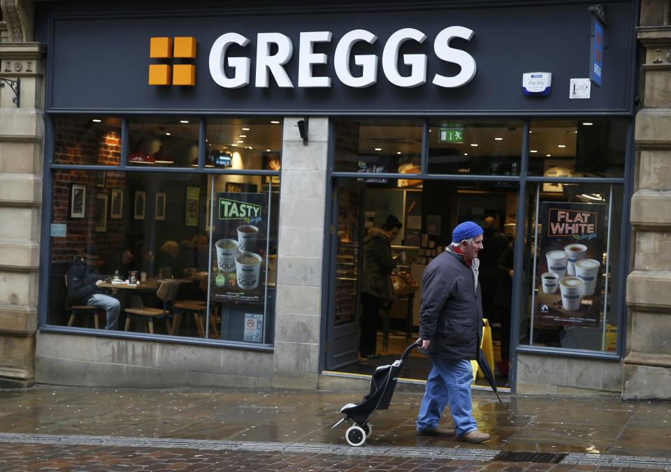 A man walks past a Greggs bakery in Bradford, Britain March 1, 2016. Greggs plans to close three bakeries and cut up to 355 jobs as part of a 100-million-pound ($140 million) restructuring programme, the British baker announced on Tuesday. REUTERS/Phil Noble