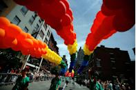 <p>Participants march with rainbow balloons in the Gay Pride Parade in June in New York City.</p>