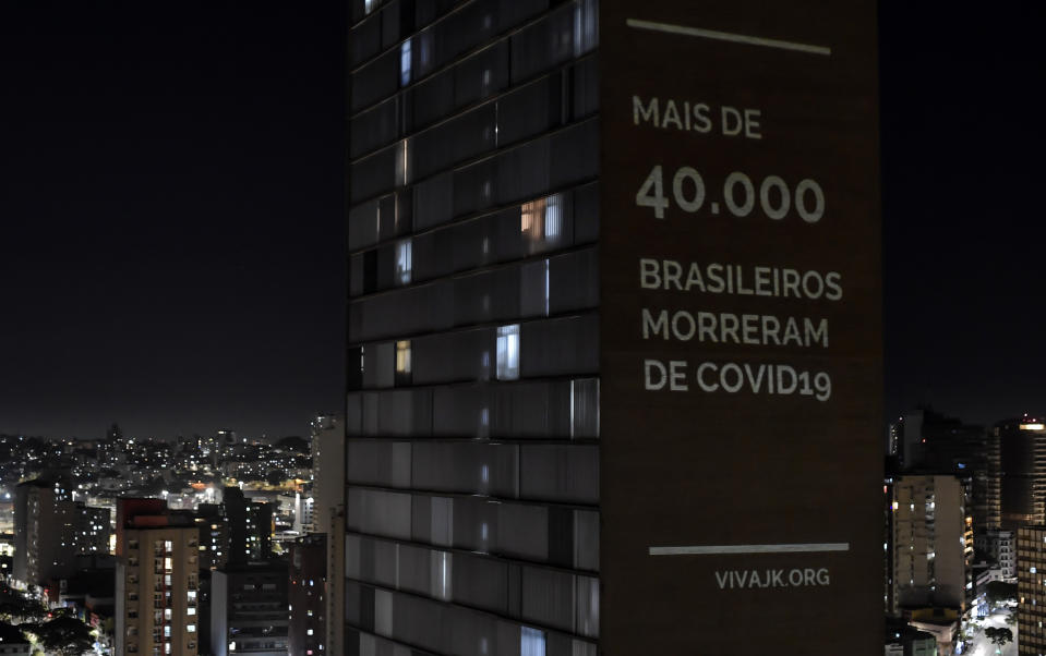 """View of a projection reading """"Over 40,000 Brazilians have died from COVID-19"""", by VivaJK movement, in one of the towers of the JK building, in Belo Horizonte, state of Minas Gerais, Brazil, on June 11, 2020. (Photo by STR / AFP) (Photo by STR/AFP via Getty Images)"""