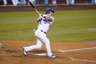 Los Angeles Dodgers' Yoshi Tsutsugo strikes out during the seventh inning of a baseball game against the Arizona Diamondbacks Thursday, May 20, 2021, in Los Angeles. (AP Photo/Mark J. Terrill)