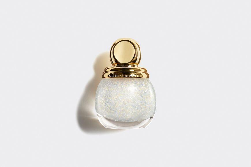 """<p>Golden nights nail varnish, £22.50, Dior.</p><p><a class=""""link rapid-noclick-resp"""" href=""""https://go.redirectingat.com?id=127X1599956&url=https%3A%2F%2Fwww.dior.com%2Fen_gb%2Fproducts%2Fbeauty-Y0189000-diorific-vernis-golden-nights-collection-limited-edition-top-coat-nail-lacquer-glitter-manicure&sref=https%3A%2F%2Fwww.townandcountrymag.com%2Fuk%2Fstyle%2Ffashion%2Fg35053771%2Fnew-years-eve-party%2F"""" rel=""""nofollow noopener"""" target=""""_blank"""" data-ylk=""""slk:SHOP NOW"""">SHOP NOW</a></p>"""