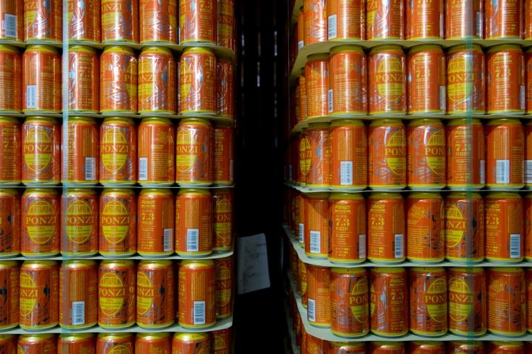 Cans of IPA beer are stocked at Atlas Brew Works in Washington