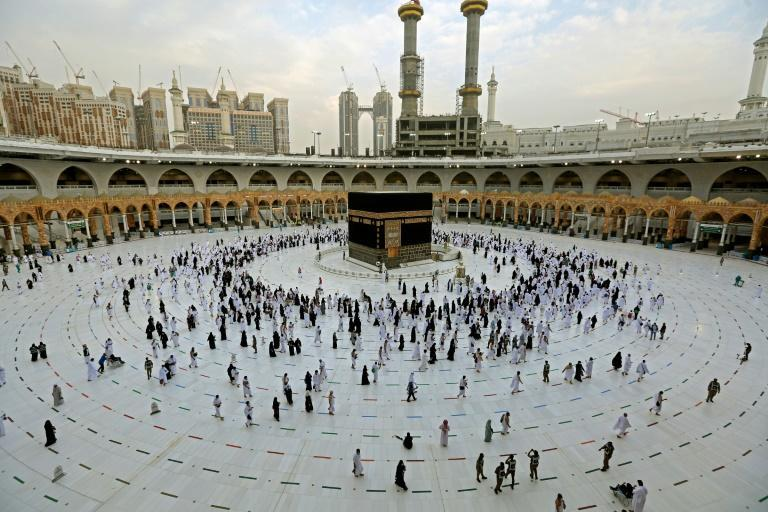 Worshippers circumambulate the Kaaba, Islam's holiest shrine, at the Grand Mosque in the holy Saudi city of Mecca, on the first day of the al-Adha feast celebrated by Muslims worldwide, on July 20