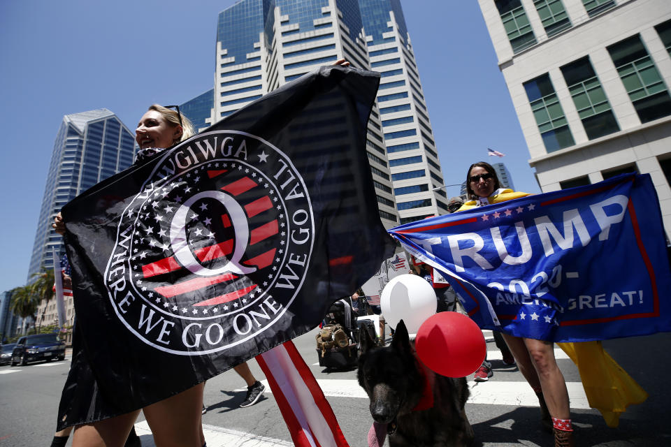 QAnon conspiracy theorists hold signs and protest the California lockdown due to the coronavirus (COVID-19) pandemic on May 01, 2020 in San Diego, California.  (Sean M. Haffey/Getty Images)