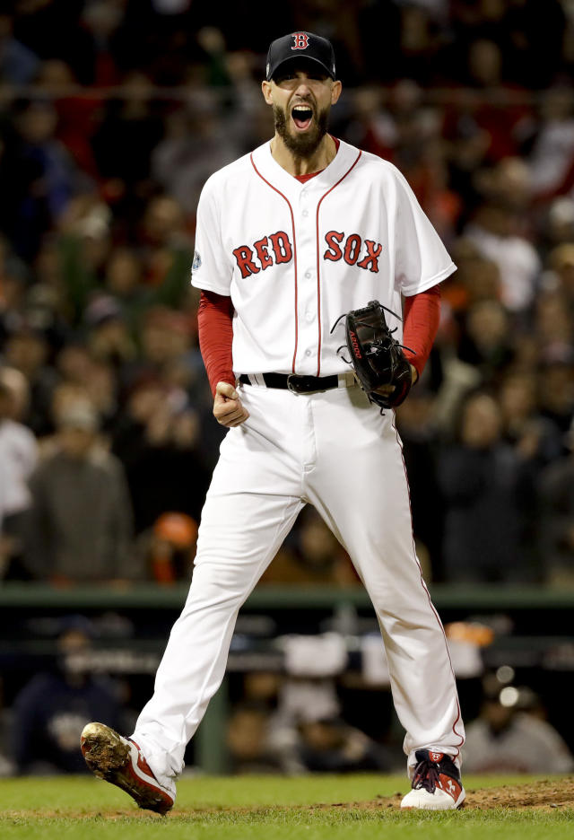 Boston Red Sox pitcher Rick Porcello celebrates after the last out in the top of the eighth inning in Game 2 of a baseball American League Championship Series against the Houston Astros on Sunday, Oct. 14, 2018, in Boston. (AP Photo/David J. Phillip)