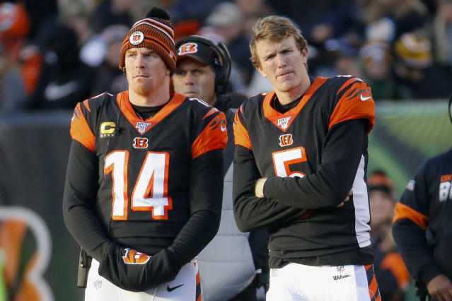Three weeks after benching veteran Andy Dalton, left, for rookie Ryan Finley, Cincinnati Bengals coach Zac Taylor said Monday he's going back to Dalton. (AP/Frank Victores)