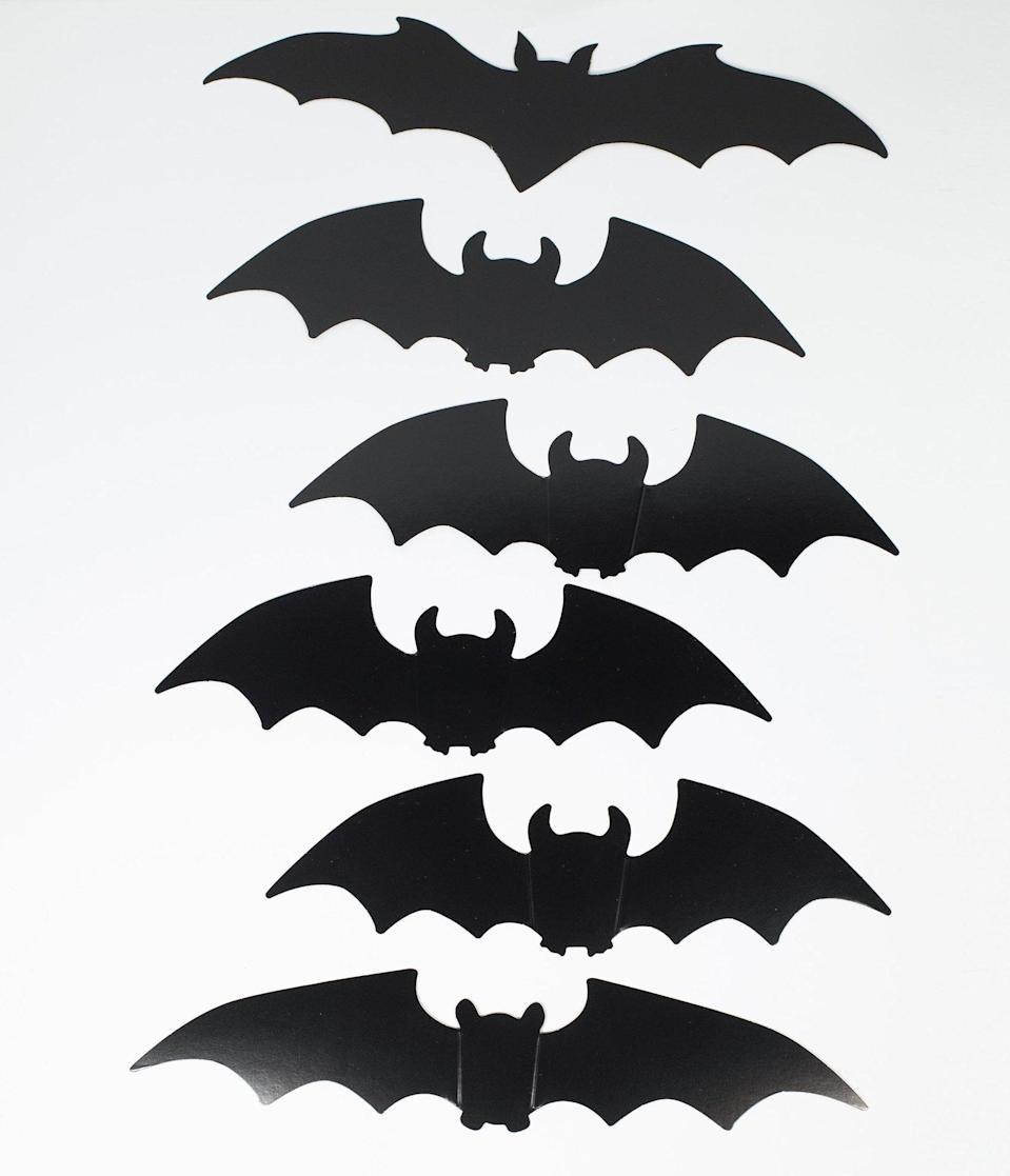 <p>Adorn your home in these creep-tastic <span>Black Bat Silhouette Paper Cutouts Set</span> ($16).</p>