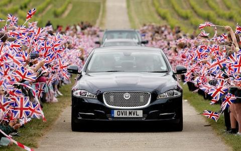 Jaguar car with UK flags - Credit: Getty