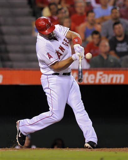 Los Angeles Angels' Albert Pujols hits a two-run single during the third inning of their baseball game against the Chicago White Sox, Friday, Sept. 21, 2012, in Anaheim, Calif. AP Photo/Mark J. Terrill)