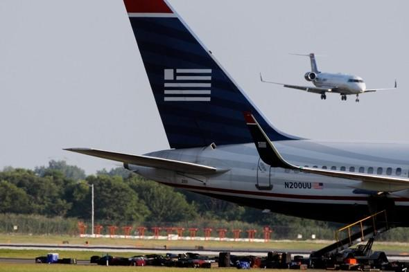 Pilot arrested for boarding plane with 'loaded gun'