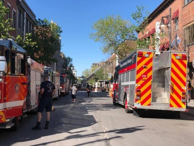 Montreal fireighters say the fire originated on the third floor of the building. ( Shuyee Lee/CBC - image credit)