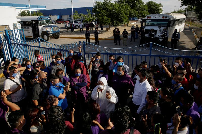 FILE PHOTO: Susana Prieto, a lawyer and labor activist, advises employees of an Electrocomponentes de Mexico factory during a protest to halt work amid the spread of the coronavirus disease (COVID-19), in Ciudad Juarez
