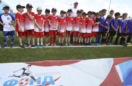 In this photo taken on Thursday, May 17, 2018, teams stand in a line during a children soccer tournament at the Start Stadium in Saransk, Russia. The Start Stadium in Saransk may not look like much, but its the jumping-off point for hundreds of young Russians dreams of soccer stardom. (AP Photo)
