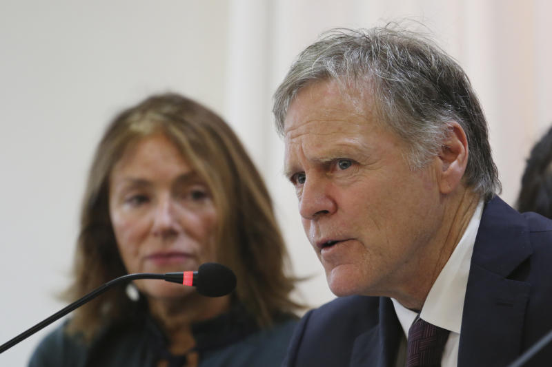 Fred Warmbier, right, speaks as his wife Cindy listens about their son Otto Warmbier who died after being released by North Korea during a press conference in Seoul, South Korea, Friday, Nov. 22, 2019. The Warmbiers say they are committed to finding and shutting down illicit North Korean business assets around the world in efforts to hold its government accountable for widespread human rights abuses. (AP Photo/Ahn Young-joon)