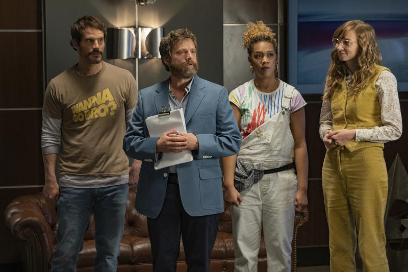 """This image released by Netflix shows Ryan Gaul, from left, Zach Galifianakis, Jiavani Linayao and Lauren Lapkus in """"Between Two Ferns: The Movie."""" (Adam Rose/Netflix via AP)"""