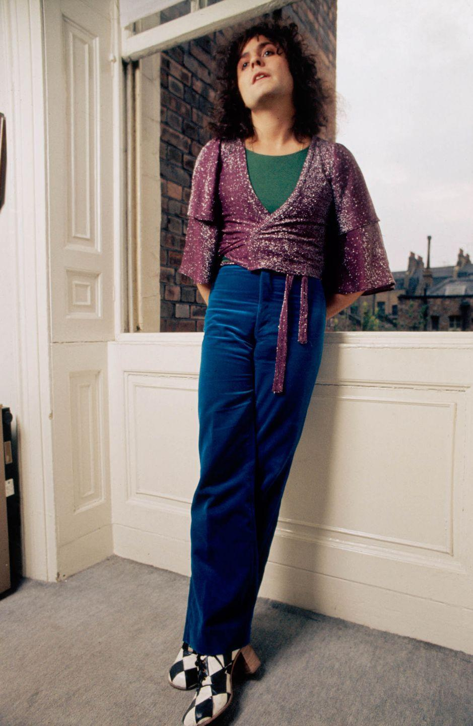 <p>Glam rock star Marc Bolan, frontman for the act T. Rex, at home in velvet trousers and checkered shoes in 1975.</p>
