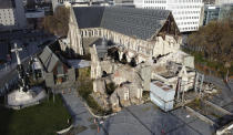 This shows an aerial view of the 2011 earthquake damaged Christ Church Cathedral in central in Christchurch, New Zealand, on May 11, 2020. The Christ Church Cathedral was arguably New Zealand's most iconic building before much of it crumbled during an earthquake 10 years ago. The years of debate that followed over whether the ruins should be rebuilt or demolished came to symbolize the paralysis that has sometimes afflicted the broader rebuild of Christchurch. But as the city on Monday, Feb. 22, 2021 marks one decade since the quake struck, killing 185 people and upending countless more lives, there are finally signs of progress on the cathedral. It's being rebuilt to look much like the original that was finished in 1904, only with modern-day improvements to make it warmer and safer. (AP Photo/Mark Baker)