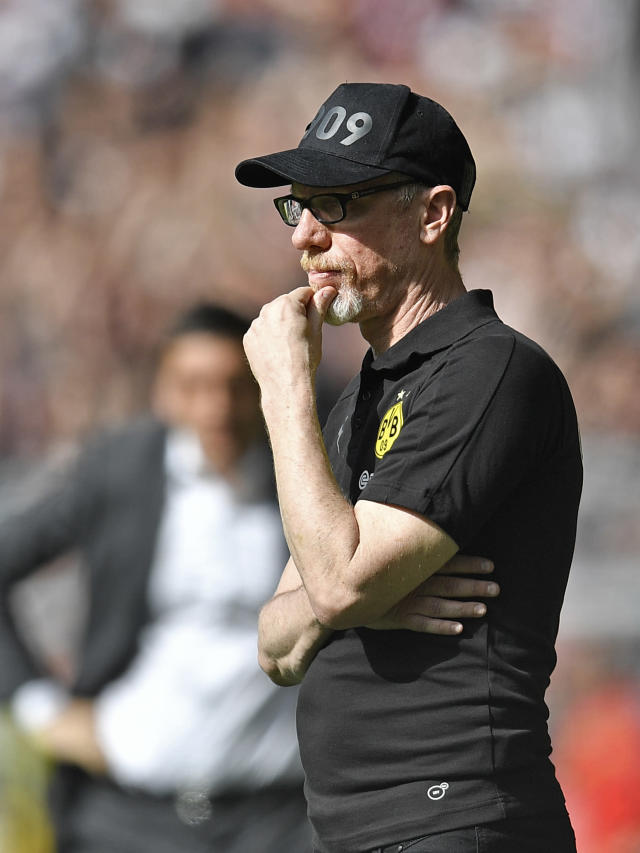 Dortmund's head coach Peter Stoeger watches during the German Bundesliga soccer match between Borussia Dortmund and VfB Stuttgart in Dortmund, Germany, Sunday, April 8, 2018. (AP Photo/Martin Meissner)
