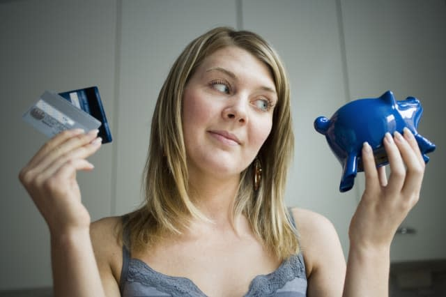 Girl with credit cards and piggy bank