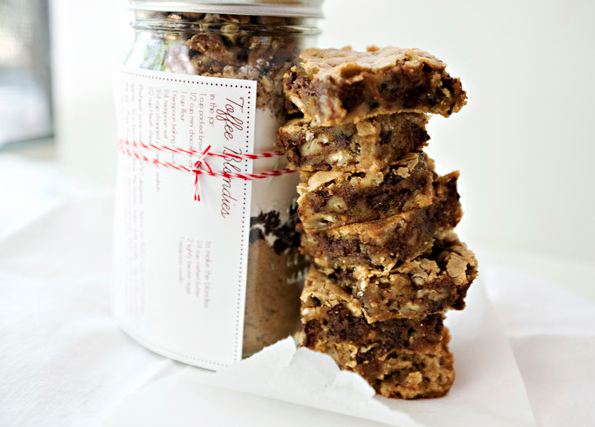 For the baker in your life, fill a jar with all of the ingredients they'll need to make these delish toffee blondies - or another baked good you know they'll love. Attach a recipe card with whatever the fresh ingredients they'll need to add in and the cooking instructions. [Photo: Baked Bree]