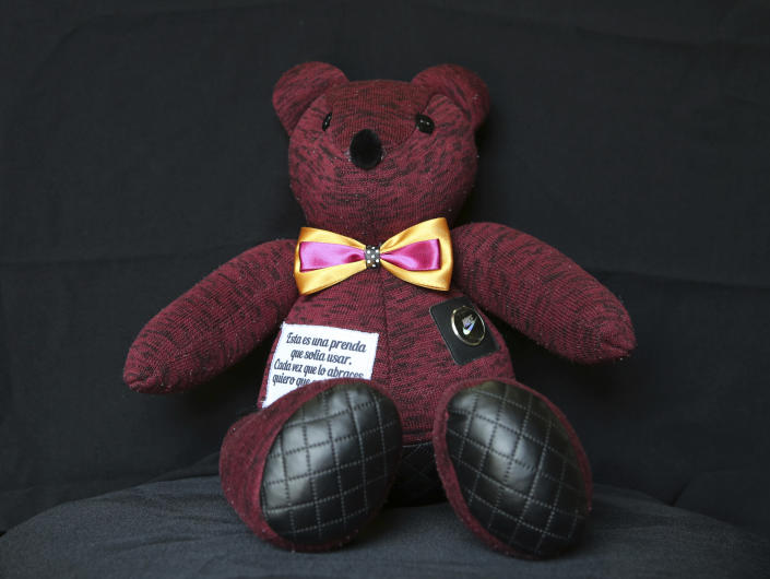 A teddy bear made with pieces of clothing that were worn by a COVID-19 victim, sits in the workshop of seamstress Irma de la Parra, in Mexico City, Saturday, April 24, 2021. De la Parra used to make teachers' gowns, but school closings during the pandemic left her without a job. She took it upon herself to make teddy bears out of clothing from those who died of COVID-19 to give those who are still alive a chance to grieve and be closer to those they were unable to bid farewell to. (AP Photo/Ginnette Riquelme)