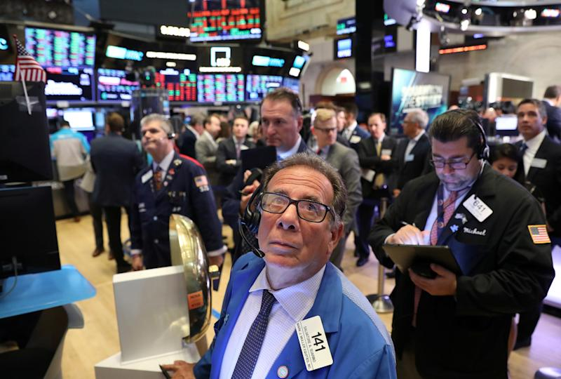 Traders work on the main trading floor of New York Stock Exchange (NYSE) after the opening bell of the trading session in New York City, New York, U.S., July 25, 2019. REUTERS/Brendan McDermid