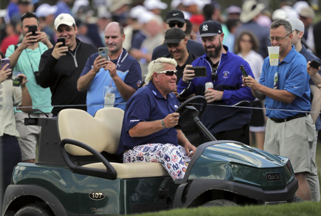 John Daly drives to the 10th tee in a golf cart during the first round of the PGA Championship golf tournament, Thursday, May 16, 2019, at Bethpage Black in Farmingdale, N.Y. (AP Photo/Charles Krupa)