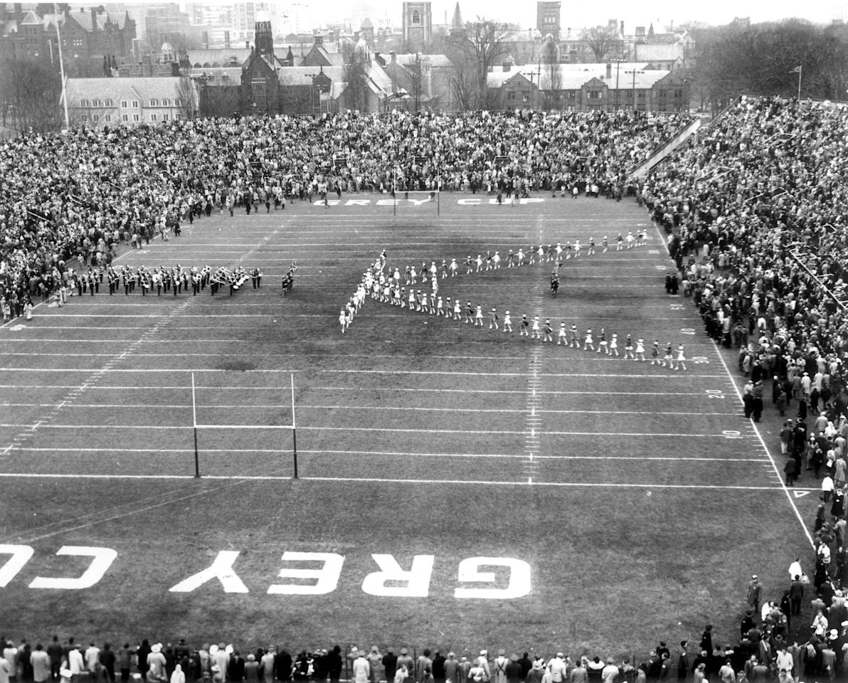Half-time show for 27,391 fans at the last Grey Cup football game played in Varsity Stadium in Toronto on November 30, 1957.  The Hamilton Tiger-Cats scored 32 against the Winnipeg Blue Bombers 7.   Photo by John Boyd / The Globe and Mail  Pub. Feb. 14, 1959 in The  Globe Magazine