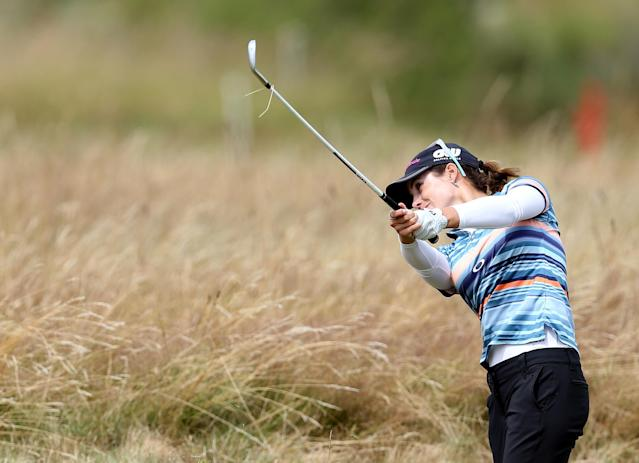 Spain's Beatriz Recari plays her shot from the rough on the 11th fairway during the third day of the Women's British Open golf championship at the Royal Birkdale Golf Club, in Southport, England, Saturday, July 12, 2014. (AP Photo/Scott Heppell)