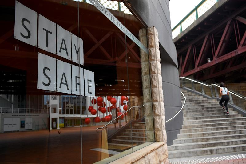 Closed businesses are seen around the usually busy Darling Harbour precinct, in Sydney.