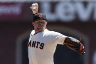 San Francisco Giants starting pitcher Logan Webb throws against the Texas Rangers during the first inning of a baseball game in San Francisco, Tuesday, May 11, 2021. (AP Photo/John Hefti)