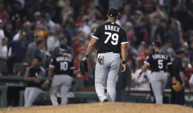 Chicago White Sox first baseman Jose Abreu (79) and teammates walk off the field after a loss to the Boston Red Sox in a baseball game at Fenway Park in Boston, Monday, June 24, 2019. (AP Photo/Charles Krupa)