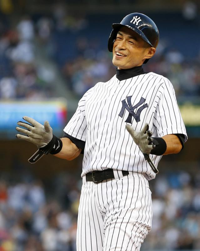 NEW YORK, NY - AUGUST 21: Ichiro Suzuki #31 of the New York Yankees reacts to his teammates pouring onto the field after hitting a single, his 4,000 career hit in the first inning against the Toronto Blue Jays in a MLB baseball game at Yankee Stadium on August 121, 2013 in the Bronx borough of New York City. (Photo by Rich Schultz/Getty Images)