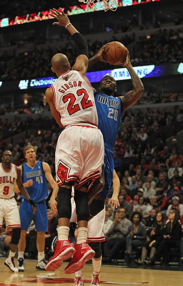CHICAGO, IL - APRIL 21: Ian Mahinmi #28 of the Dallas Mavericks tries to shoot and is fouled by Taj Gibson #22 of the Chicago Bulls at the United Center on April 21, 2012 in Chicago, Illinois. NOTE TO USER: User expressly acknowledges and agress that, by downloading and/or using this photograph, User is consenting to the terms and conditions of the Getty Images License Agreement. (Photo by Jonathan Daniel/Getty Images)