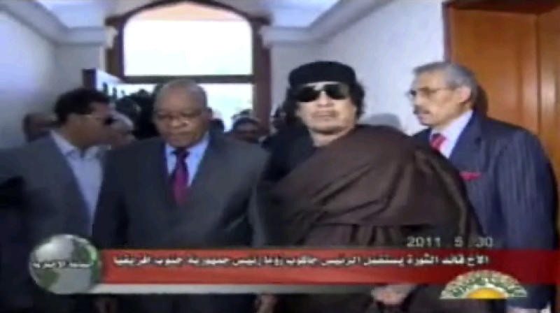 This video image taken from Libyan state television broadcast Monday, May 30, 2011 shows Libyan leader Moammar Gadhafi, right, and South African president Jacob Zuma before a meeting in Tripoli, Libya. Gadhafi is ready for a truce to stop the fighting in his country, Zuma said Monday after the meeting, but he listed familiar Gadhafi conditions that have scuttled previous cease-fire efforts. (AP Photo/Libyan state television via APTN) LIBYA OUT, TV OUT