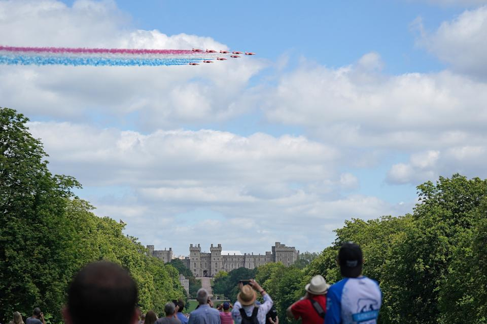 The Red Arrows fly over Windsor Castle to mark the official birthday of Queen Elizabeth II. Picture date: Saturday June 12, 2021.