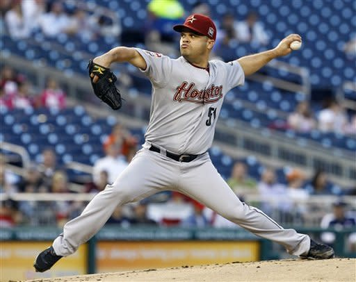 Houston Astros starting pitcher Wandy Rodriguez (51) delivers to the Washington Nationals during the first inning of a baseball game in Washington, Tuesday, April 17, 2012. (AP Photo/Ann Heisenfelt)
