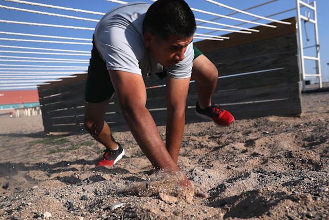 <p>A U.S. Border Patrol trainee runs an obstacle course at the U.S. Border Patrol Academy on August 3, 2017 in Artesia, N.M. (Photo: John Moore/Getty Images) </p>