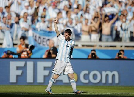 Argentina's Lionel Messi celebrates after scoring against Iran during their 2014 World Cup Group F soccer match at the Mineirao stadium in Belo Horizonte