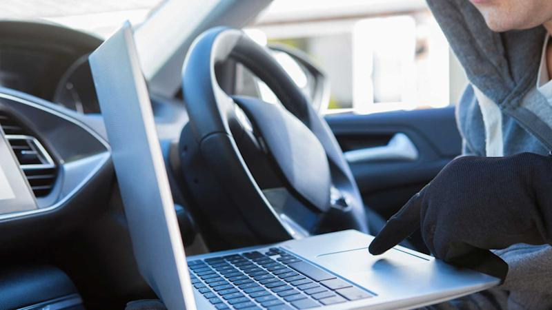 Thief using laptop to hack into car security software