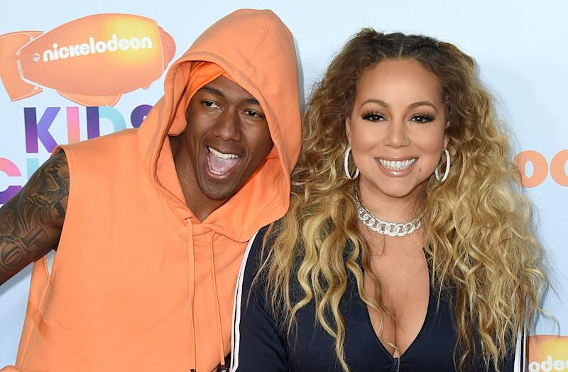 Nick Cannon, left, and Mariah Carey arrive at the Kids' Choice Awards at the Galen Center on Saturday, March 11, 2017, in Los Angeles.