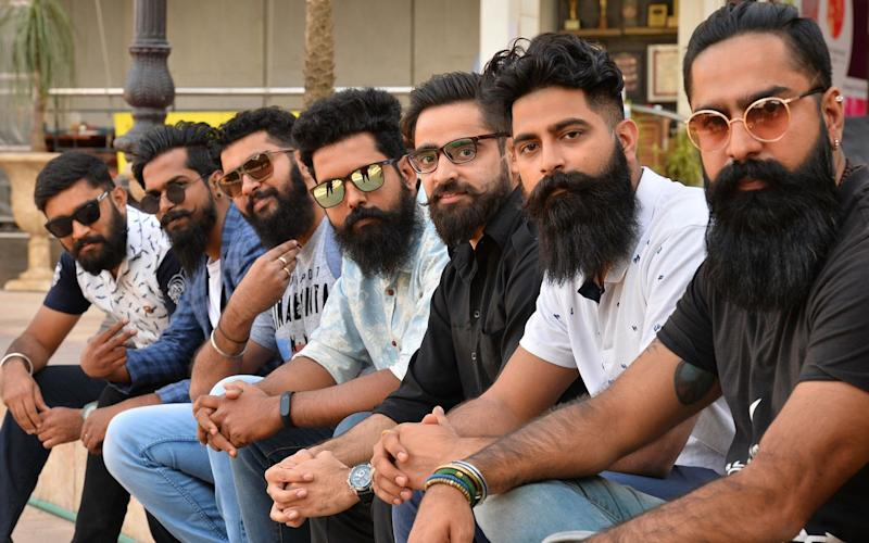 A group of men with beards pose for a photograph at a beard competition in Bangalore - AFP or licensors