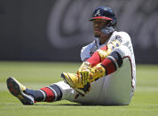 Atlanta Braves' Ronald Acuna Jr. grabs his left foot after falling in the seventh inning of a baseball game against the Toronto Blue Jays on Thursday, May 13, 2021, in Atlanta. (AP Photo/Ben Margot)